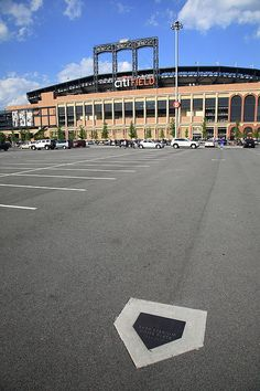 Citi Field - New York Mets. With home plate of old Shea Stadium in foreground.