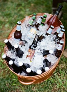 Make the Bar Self-Serve  Make beverage service easier by filling up a big tub of ice with beer, soda and bottles of wine so guests can help themselves!