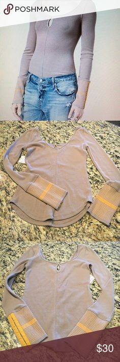 FREE PEOPLE Top Stretchy cool Free People taupe top with super cool orange color blocked hook and eye sleeves.  Peekaboo back neckline. Add stunning to those jeans.  Taupe color only.  Large and medium available.  NWT. Free People Tops