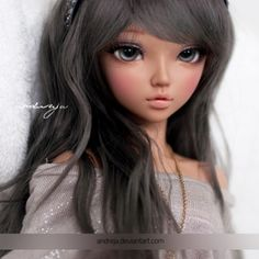 Katie, remember how you said you didn't want a tan bjd, cause it looked like a fake barbie? Here is just an example to show you from this company. This is a tan minifee Chloe. So, it's from the company we will be getting it, even with the face sculpt you chose, just an example so you can see :D