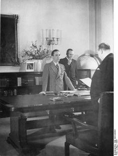 Josef Goebbels in a meeting with Government Secretary Walter Funk at the Propaganda Ministry, Berlin, Germany, 1937; Goebbels' personal secretary Karl Hanke in background