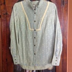 """Free People-Japanese Floral button-down Denim Super soft 100% cotton denim, bib style button-down denim shirt in vintage color blue (intentional vintage looking color) with cream flowers and cream accent.  Muted brass buttons...Measures from pit to pit:  21 1/2"""", shoulder to hem front: 27"""" & back 29"""".  EUC Free People Tops Button Down Shirts"""