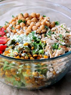 Healthy Chicken Chickpea Chopped Salad: who doesn't love a good chopped salad?! Especially with summer right around the corner. This recipe fills your bowl with all the food groups: lean protein, fruit, veggie, and low fat dairy. AWESOME!