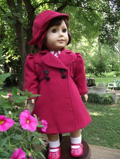 *******American Girl 1940s Wool Coat and Cloche Hat by VintiqueDesigns. What a LOVELY set from Linda! A-line design coat from a vintage child's coat pattern resized by K & R Vintage patterns for AG dolls. Double breasted front closes with two working buttons and holes and two other buttons on the other side. Wide lapel collar, pleated sleeves that end in a deep cuff, and bodice inset panels front and back for style and fit. Just perfect, isn't it?