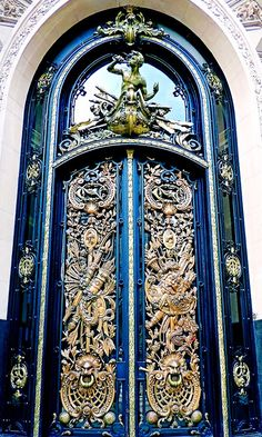 Elaborate details on this blue door in Buenos Aires, Argentina.