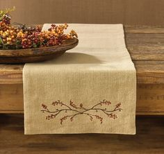 """Burlap & Bittersweet Table Runner measures 13"""" x 72"""" and can be used in the center of the table. Add side matching bittersweet placemats for additional place settings. This pattern coordinates with our Hayride plaid pattern. Check out all of our fall decorating textiles at CountryPorch.com"""