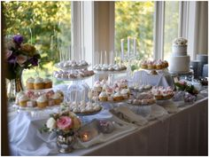 Different levels on dessert buffet table, a variety of baked goods