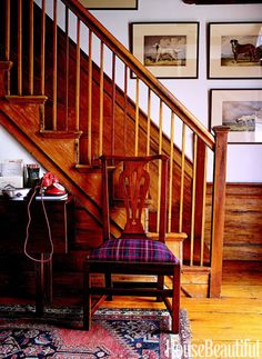The wainscoting and casework of this wooden staircase was stripped and finished with clear tung oil.