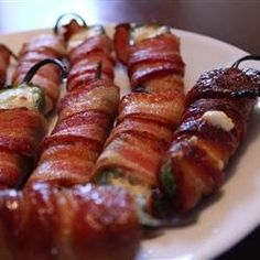 Grilled Bacon Jalapeno Wraps | Jalapenos are stuffed with cream cheese, wrapped with bacon, and barbecued on the grill