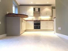Lima Kitchens Marlow Painted Putty kitchen with walnut worktops and porcelain floor tiles