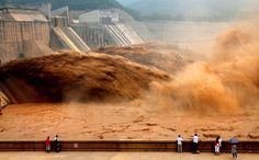 Flood water gushes from the Xiaolangdi Reservoir, on the Yellow River in Jiyuan, central Chinas Henan Province. (Photo by Miao Qiunao/Xinhua/Associated Press) http://avaxnews.net/appealing/China_Land_of_Contrasts.html #avaxnews.net #photo #travel #china #funny