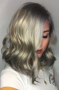Beautiful icy hair created by lightening hair all over with Wella Blondor and 20 vol. Then neutralize with iNSTAMATiC Muted Mauve for 10 mins. Finally, tone the roots to end with Color Touch 9/16 40 g 8/81 30g and /68 10g with 6 volume 160g for 20 mins.
