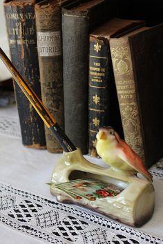 old books with vintage pen holder