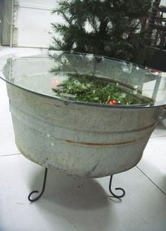 using an old window as a top for a galvanized tub   The finished wash tub coffee table. The top easily removes so the ...