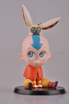 """Avatar Aang is stylized as a squat and adorable character. The figure includes his companion Momo, resting on top of his head. The figure comes in at approx. 5"""" high including Momo and stand."""