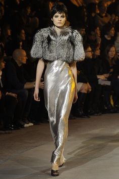 Pin for Later: Why We Consider Marc Jacobs the Clever Chameleon of Designers Fall 2013 The slinky lingerie-inspired collection paired sultry metallic lamé with miles of fur.