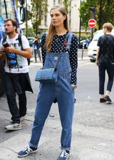 25 Perfect Overalls Outfits for Spring - loose fit denim overalls layered over a polka dot shirt, + worn with Adidas sneakers and Chanel boy bag
