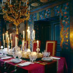 Blue, red and gold dining room by Alidad Design with embossed, decorated leather walls and a trompe l'oeil ceiling