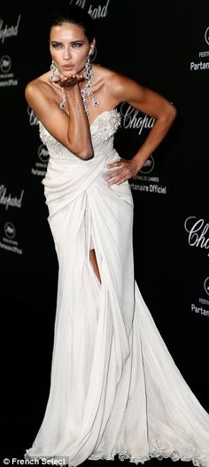 Adriana Lima looked positively Fabulous in this full length white gown as she attended the Chopard party in Cannes on Mon...