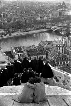 School-children looking down from the top of the Notre-dame Cathedral at the Seine River, Paris, 1953
