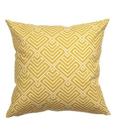 Cushion cover in woven cotton fabric with a printed pattern at front and solid color at back. Concealed zip.
