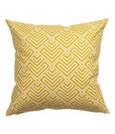 Kissenhülle aus Baumwolle mit Musterdruck auf der Vorderseite und einfarbiger Rückseite. Verdeckter Reißverschluss.
