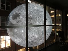artist luke jerram is taking a seven meter diameter moon across the world. the touring art installation is lit from within, illuminating hyper-detailed NASA imagery sourced from the lunar surface.