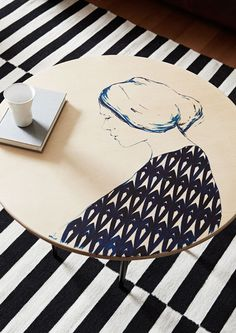 The Melbourne apartment of Jacqui Vidal of Signed & Numbered, her partner Casey McCutcheon and their two year old daughter Ellis. Handpainted coffee table by Melbourne artist Miso. Photo - Annette O'Brien, styling – Alana Langan of Hunt & Bow.