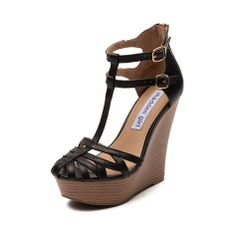 Shop for Womens Madden Girl Cage Wedge in Black at Journeys Shoes. Shop today for the hottest brands in mens shoes and womens shoes at Journeys.com.Cage some first class cuteness and with this stunning t-strap wedge from Madden Girl! The Cage Wedge features a strappy faux leather upper, birdcage toe, dual buckle ankle strap fastener, and rear heel zipper for easy on-and-off access. 5 stacked wedge heel, 1.5 platform. Available for shipment in February; pre-order yours today!