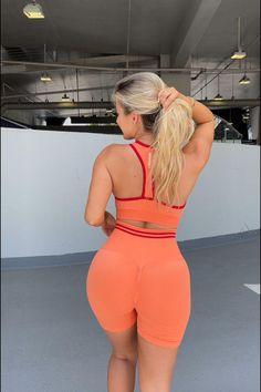 30% OFF Scrunch Seamless Crop + Leggings In Cantaloupe Orange   10 colours, 3 styles. #Doyouevenwomen #LeaveYourMark #DYEScrunchClub #activewear #matchingsets #activewearoutfits #gymwear #sportswear #fitness #outfitideas #athleisure #fitnessmodels #womensfashion Activewear Sets, Orange Shorts, Sporty Style, Gym Wear, Active Wear For Women, Athleisure, Stretch Fabric, Fitness Models, Sportswear