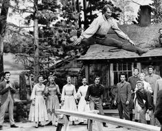 seven brides for seven brothers - The barn raising!  This is my favorite scene from the movie.  The dancing is phenomenal!!