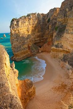 This popular Portugal beach is known as one of the most beautiful beaches in the Algarve region. While sitting on the golden sands, you'll be surrounded by the natural beauty of picturesque strata cliffs and crystal clear waters. Love happens in Portugal. Most Beautiful Beaches, Beautiful World, Beautiful Places, Beautiful Scenery, Amazing Places, Wonderful Places, Lagos Algarve, Places To Travel, Places To Visit
