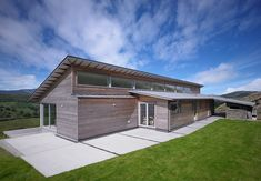 Completed in 2009 in Castle Douglas, United Kingdom. Images by Simon Winstanley Architects. The Houl, , is a contemporary single storey 'long house' which is recessive in the landscape, sustainable in its construction and achieves a 'zero. Building Plans, Building A House, Green Building, Roof Design, House Design, Long House, Architect House, House Roof, Designer