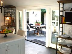 Double Doors From Kitchen To Porch Via Classic  Casual  Home
