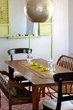 The pendant is so pretty, especially with that table and touches of green.