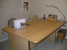 Sewing table with recessed area for machine for easier sewing and quilting. Table is large enough for craft projects too. Love it!