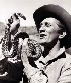 """Kirk Douglas holds a snake on the set of """"The Indian Fighter""""  1956"""