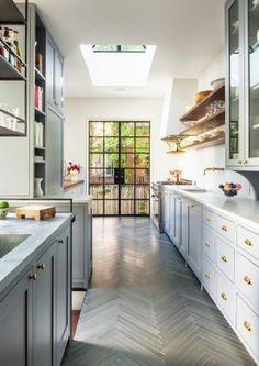 beautiful galley kitchen with hardwood floors