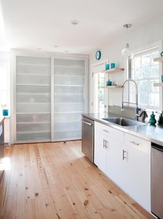 Frosted Sliding Pantry Doors by Plain & Fancy Custom Cabinetry