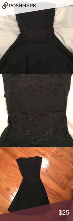 Bebe black tight dress with lace cut outs Only worn a few times ! So cute and comfy material. Has lace in middle and top. See pics. Zippers in back. bebe Dresses