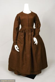 Augusta Auctions - brown wool work dress & apron, France, 1840s; small geometric pattern, rounded piped neck, center front hook & eye closure, two patch pocket tie-on apron with two rows of smocking at top; bodice lined in woven tan striped cotton, skirt lined in blue & tan pinstripe, brown linen hem facing.