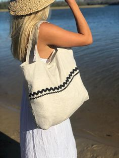 100 % natural linen tote/ market / beach/ grocery bag. Hand made in my studio in Kalaru Australia. Beautiful crumply mid weight natural linen bag. Accented with ric rac trim. Make a statement with this stylish bag at the grocery shop, beach, anywhere you need a bag ! Bag has a