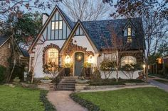 Tudor Cottage at dusk. This cottage is almost exactly what I envision in my dream place. Love the windows the perfect place to put my window flower boxes. - Tudor Houses 4 U Tudor Cottage, Cottage House Plans, Cottage Homes, English Cottage Exterior, Tudor House Exterior, English Tudor Homes, Brick Cottage, English House, Cute House