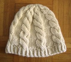 chunky cable hat pattern *free*  simple and quick cables by Emily Wessel...This basic cable hat is a free pattern, intended as a perfect first project when learning to cable. It is knit in the round, from the brim to the crown. It also looks great with a pompom!