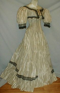 Edwardian black and white dress with faux bolero. Clever use of darts to shrink the stripes closer together, giving a nice unbroken, flattering line, while visually accentuating the waist.