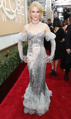 Golden Globes 2017: The Biggest Risk Takers of the NightNICOLE KIDMAN   There are very few people who can pull off an Alexander McQueen completely-embellished, sheer gown with ruffled train, and even fewer who would dare bring back pouffy '80s arm warmers. But that person is Nicole Kidman.