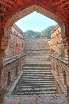 Rajon ki Baoli, a three-story stepwell believed to have been built by Daulat Khan during the reign of Sikandar Lodi in 1516, is located near 16th-century general Adham Khan's tomb in Mehrauli, Delhi. - Discover 6 of India's Incredible Stepwells Photos | Architectural Digest