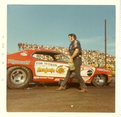 Tom McEwen's Mongoose about the time I was hunting for a replica of this car as a 'Hot Wheel' in the local toy stores, 1970 - check out the pit crew sideburns, pointy side-zipping boots and flared pants.
