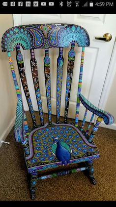 Hand painted peacock rocking chair