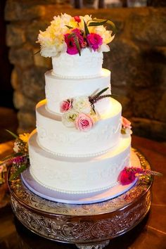 Four-tier wedding cake decorated with pink and white flowers {Brett Charles Rose Photography}